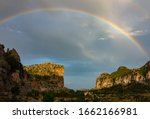 Sunset With Rainbow Over Monte...