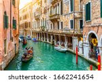 Narrow Canal With Gondola In...