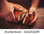 Baker's Hands With A Bread....