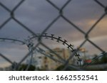 Razor Wire Fence Close Up With...