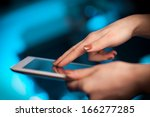 hand touching tablet pc with... | Shutterstock . vector #166277285