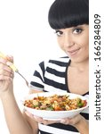 young woman eating mixed pasta... | Shutterstock . vector #166284809