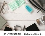 Small photo of Top view or flat lay of face mask ,sanitizer hand gel to protect against Coronavirus or COVID-19 and neccessary items for daily working life , Today's personal item for health protection concept