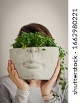 A Half Face Concrete Planter...
