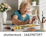Adult Senior Woman Paints A...