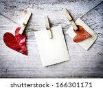Stock photo hearts and blank card red hearts hanging on the clothesline on old wood background 166301171