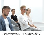 Small photo of participants in the group meeting applaud, sitting in one row