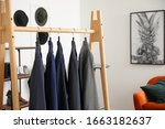 rack with stylish male clothes... | Shutterstock . vector #1663182637