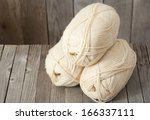 balls of wool on weathered... | Shutterstock . vector #166337111