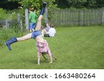 Girl Performing Cartwheel In...