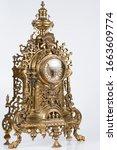 Small photo of vintage bronze watch, bronze fireplace clock, golden old desktop clock, vintage bronze clock side photo, antique clock studio photo, old bronze ticker in gilding
