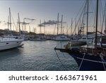 Boats In Vlichada Harbor On...