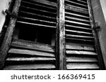 Old rustic window - horror background - stock photo