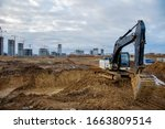 Excavator Working At...