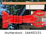 A Hanging Lobster Sign In Bar...