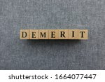 Small photo of 'DEMERIT' word made with wooden blocks