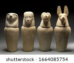 A Set Of Four Canopic Jars Was...