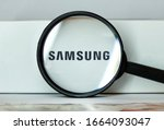 Small photo of New york. USA. 02.02.2020. Samsung. The logo of Samsung. Samsung brand company . Samsung phones . Brand logo on the phone box with a magnifying glass.