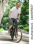 happy young man riding on... | Shutterstock . vector #166409837