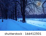bank of the river with trees covered with rime on a winter night - stock photo