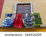 Traditional flamenco dresses at a house in Malaga, Andalusia, Spain. - stock photo