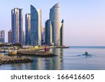 BUSAN, SOUTH KOREA - FEBRUARY 10: Haeundae District and waterfront February 10, 2013 in Busan, South Korea. The high rise district is home to many of the city's most affluent residents. - stock photo
