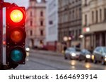 Small photo of A city crossing with a semaphore. Red light in semaphore - image