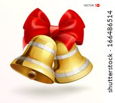 golden bells with red ribbon on ...