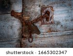 Old Door Chain And Rusty Lock