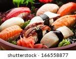 japanese cuisine   sushi set | Shutterstock . vector #166558877