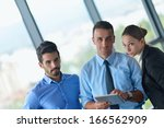 group of happy young  business... | Shutterstock . vector #166562909