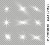 white glowing light explodes on ... | Shutterstock .eps vector #1665724597