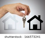 hand with key on  background | Shutterstock . vector #166573241