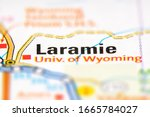 Laramie on a USA road map. Close-up on printed road map. Target of journey.