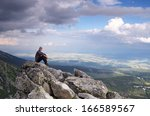 man tourist is sitting on a... | Shutterstock . vector #166589567