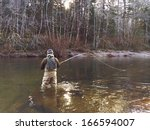 Man Fly Fishing In Cold Winter...