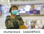 old asian woman in a mask for... | Shutterstock . vector #1666389631