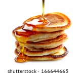 stack of pancakes isolated on... | Shutterstock . vector #166644665
