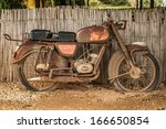 The Old  Rusty Motorcycle On A...