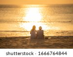 Couple In Love Watching Sunset...