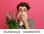 Man With Allergy Sneezes And...