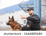 Male Police Officer With Dog...