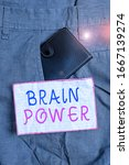 Small photo of Text sign showing Brain Power. Conceptual photo Ability to comprehend To understand and profit from experience Small little wallet inside man trousers front pocket near notation paper.