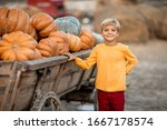 A Boy Stands Near A Wooden Car...