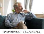 Pensive Elderly 60s Man Sit...