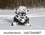 Front Of A Snowmobile Parked O...