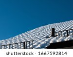 Roof Covered With Snow With A...