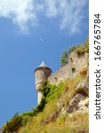 Small photo of The old tower and vallum against blue sky