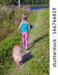 Little Girl Walking With Her...