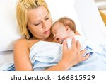 loving young mother practising... | Shutterstock . vector #166815929